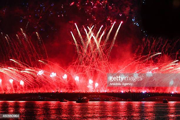 Fireworks light up the sky on the Neva River in St Petersburg early on June 21 during the Scarlet Sails with laser show and fireworks to honour high...