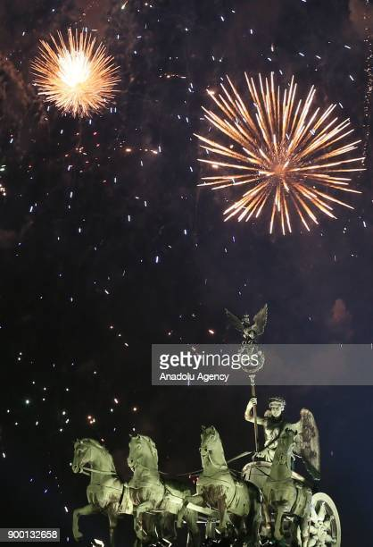 Fireworks light up the sky over Brandenburg Gate during the new year celebrations in Berlin Germany on January 01 2018