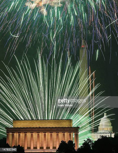 Fireworks light up the sky over the Lincoln Memorial Washington Monument and the US Capitol on July 4 2012 in Washington DC July 4th is a national...