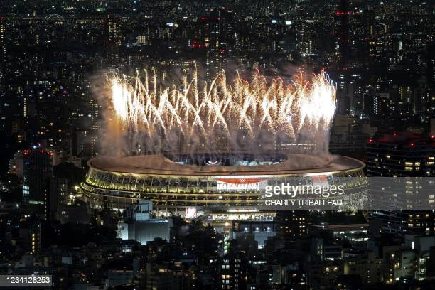 Fireworks light up the sky over the Olympic Stadium during the opening ceremony of the Tokyo 2020 Olympic Games, in Tokyo, on July 23, 2021.