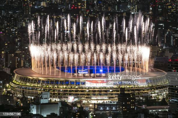 Fireworks light up the sky over the Olympic Stadium during the closing ceremony of the Tokyo 2020 Olympic Games, in Tokyo, on August 8, 2021.