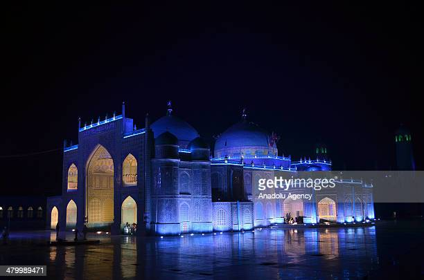 Fireworks light up the sky over the Shrine of Hazrat Ali during the Newroz celebrations in MazariSharif Afghanistan on March 21 2014 Newroz is an...