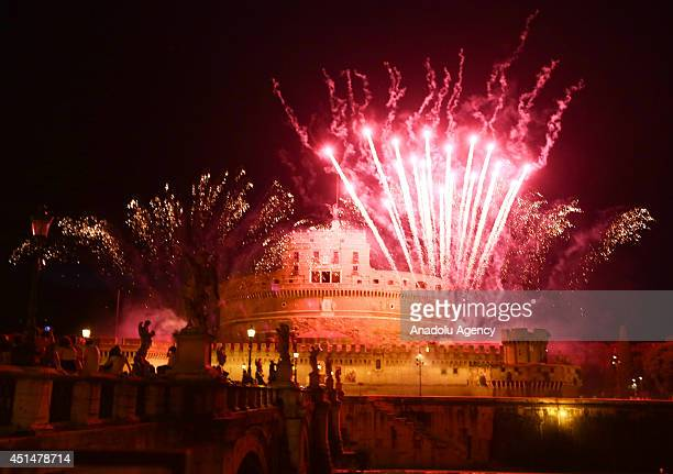Fireworks light up the sky over the Tiber river and the St Angel castle during the traditional feast of Romes patron St Peter and Paul on June 29...