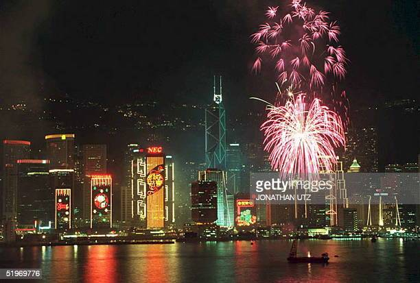 Fireworks light up the skyline of Hong Kong island 01 February 1995 during the annual Chinese New Year display Hundreds of thousands of residents...