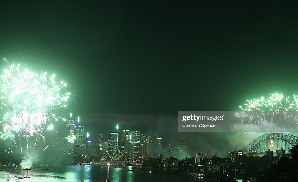Fireworks light up the skyline over Sydney Harbour during the midnight fireworks session as Sydney Celebrates New Year's Eve on December 31, 2010 in Sydney, Australia.