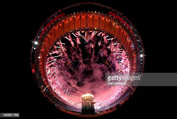 Fireworks light up the stadium as the Paralympic Caudron burns during the Opening Ceremony of the London 2012 Paralympics at the Olympic Stadium on...