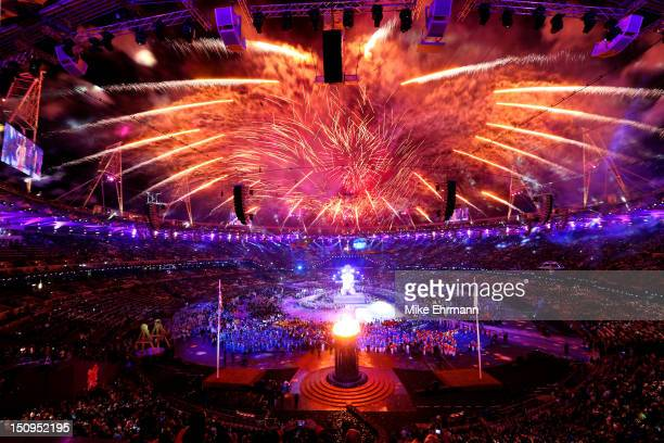 Fireworks light up the stadium as the Paralympic Cauldron burns during the Opening Ceremony of the London 2012 Paralympics at the Olympic Stadium on...