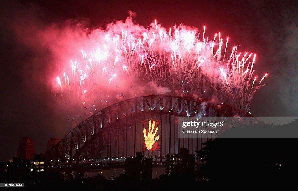 Fireworks light up the Sydney Harbour Bridge during the midnight fireworks session as Sydney Celebrates New Year's Eve on December 31, 2010 in Sydney, Australia.