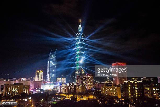 Fireworks light up the Taiwan skyline and Taipei 101 during New Years Eve celebrations just after midnight on January 1 2017 in Taipei Taiwan