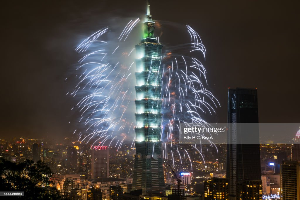 Fireworks light up the Taiwan skyline and Taipei 101 during New Years Eve celebrations just after midnight on January 1, 2018 in Taipei, Taiwan.