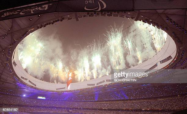 Fireworks lit up the National Stadium, better known as the Bird's Nest, at the start of the closing ceremony of the 2008 Beijing Paralympic Games in...