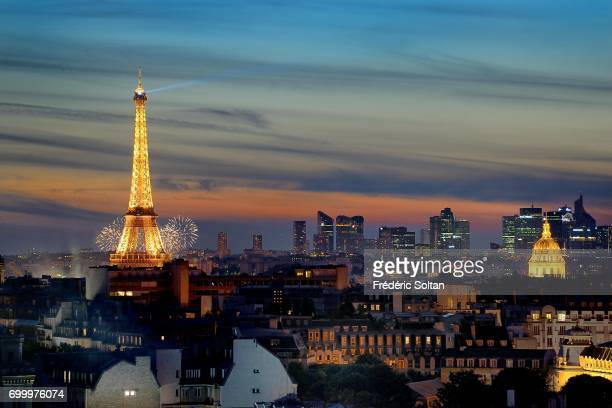 Fireworks on Eiffel tower for french national day and the modern financial district 'La Defense' in Paris on July 14 2017 in Paris France