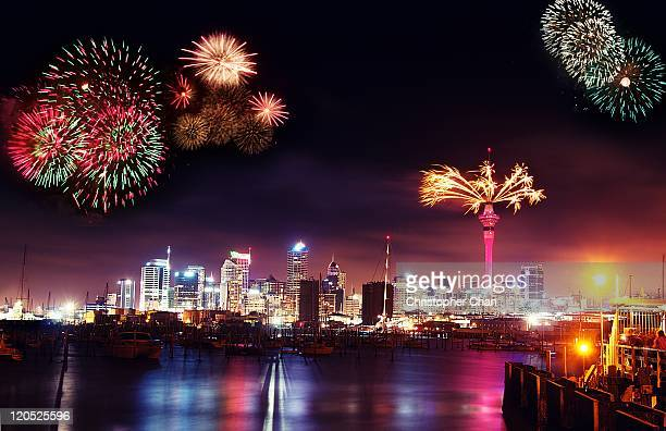 fireworks over auckland skyline - auckland stock pictures, royalty-free photos & images
