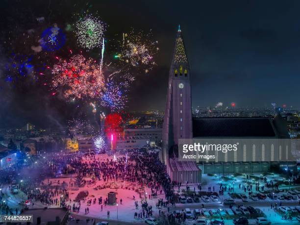 Fireworks over Hallgrimskirkja Church on New Year's Eve, Reykjavik, Iceland. This image is shot with a drone.