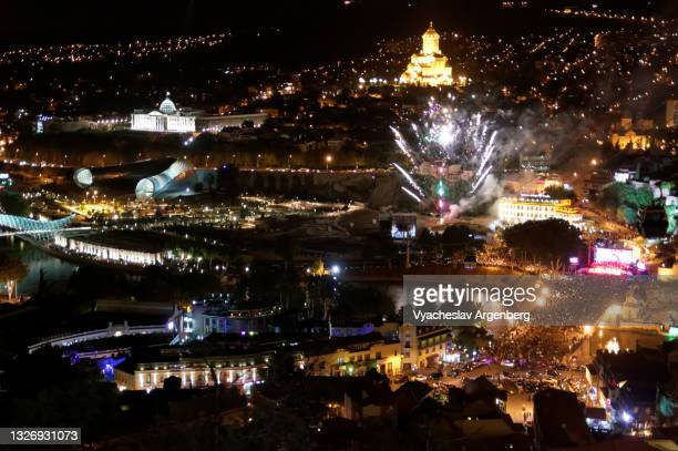 fireworks over illuminated tbilisi at night, georgia - argenberg stock pictures, royalty-free photos & images
