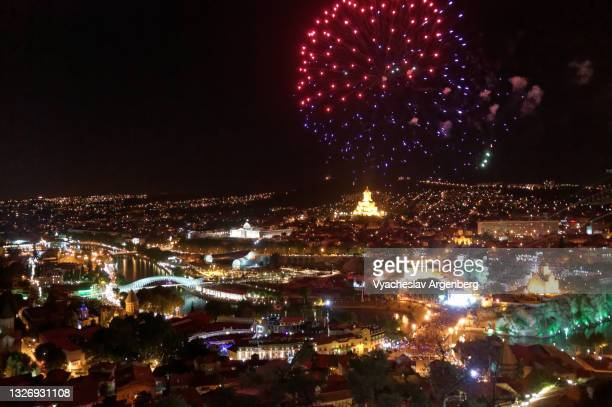 fireworks over night tbilisi, city lights, georgia - argenberg stock pictures, royalty-free photos & images
