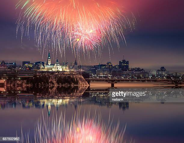 Fireworks over parliament hill with reflection, Ottawa