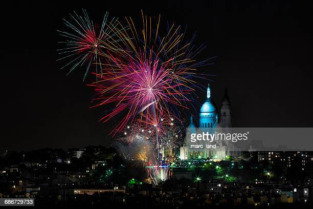 Fireworks over sacre coeur at night, paris, france