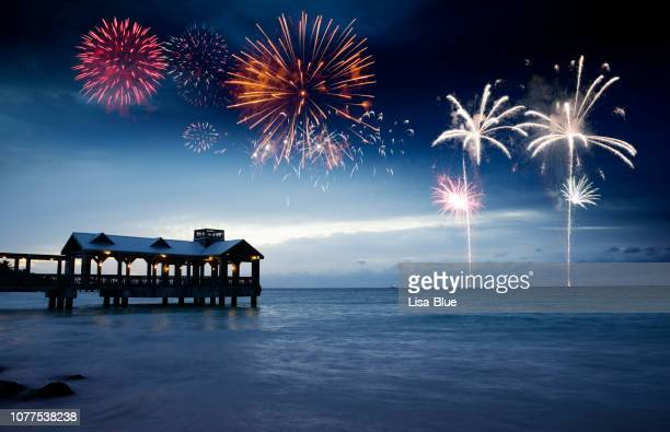 fireworks over sea, key west, florida, usa. - key west stock photos and pictures