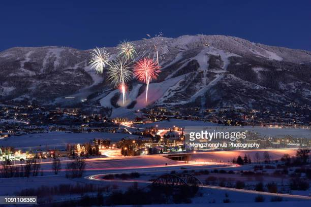 fireworks over steamboat springs ski resort - steamboat springs colorado stock photos and pictures
