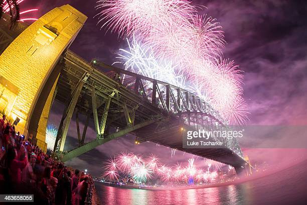 Fireworks over Sydney Harbour for the 2013 New Years celebrations. This image captures the moment fireworks were shot from Sydney Harbour Bridge. In...