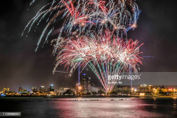 fireworks over the lake - ken ilio stock photos and pictures