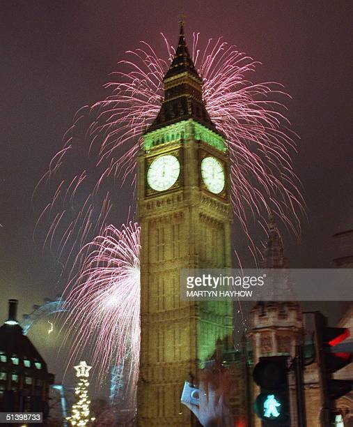 Fireworks over the River Thames light up the sky as Big Ben strikes midnight and the start of the Millenium for London 01 January 2000