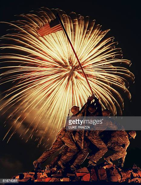 Fireworks rain in the background of the Iwo Jima Memorial in Arlington Virginia 04 July 1988 AFP PHOTO Luke FRAZZA