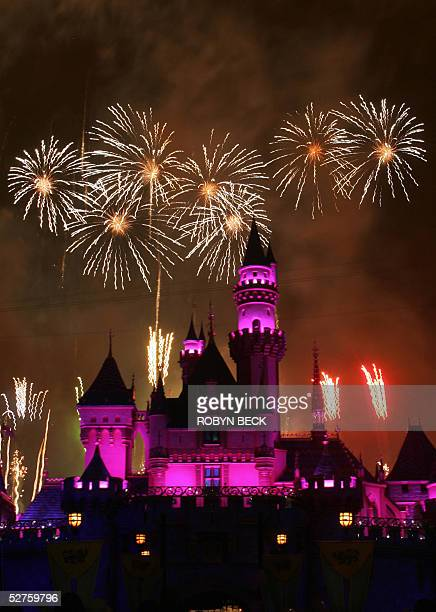 """Fireworks rise over the Sleeping Beauty Castle at Disneyland during the premier of """"Remember....Dreams Come True,"""" the new fireworks and light show..."""