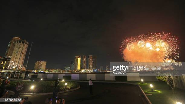 Fireworks set off as photographers take photographs during an event to officially declare the 269 hectares of land reclaimed from the sea for the...