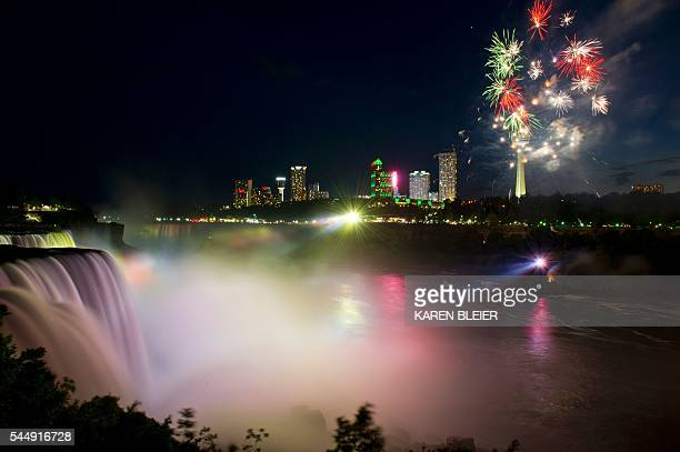 Fireworks set off from the Canadian side light up the sky over Niagra Falls late July 3 part of the July 4th US Independence Day celebrations in...