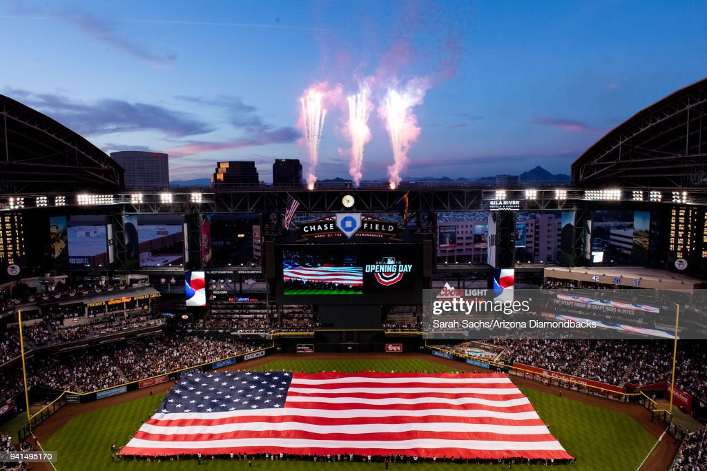 Fireworks shoot off at the conclusion of the National Anthem prior to an opening day MLB game between the Arizona Diamondbacks and the Colorado Rockies at Chase Field on March 29, 2018 in Phoenix, Arizona.