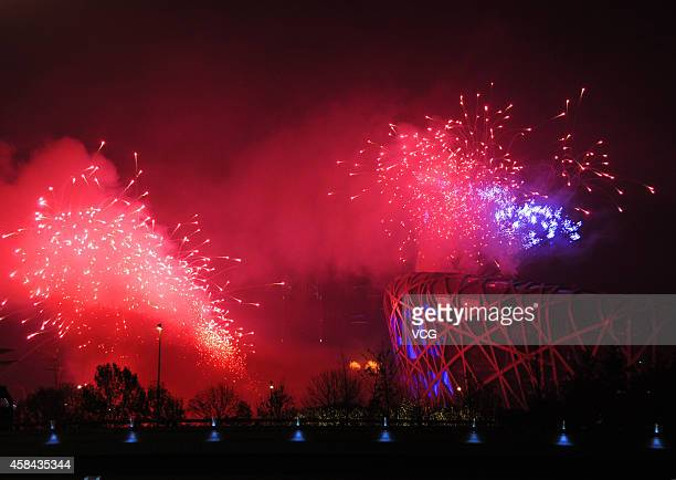 Fireworks to welcome the APEC forum are seen near the Birds Nest on November 4 2014 in Beijing China China will host the 2014 AsiaPacific Economic...