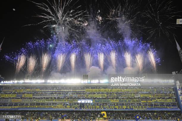 Fireworks welcome the players of Boca Juniors before the all-Argentine Copa Libertadores semi-final second leg football match against River Plate at...