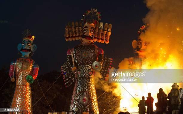 Fireworksladen effigies of the Hindu demon king Ravana his brother Kumbhkuram and son Meghanad are pictured as Hindu devotees gather for their...