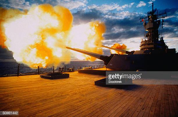 firing exercise on battleship - bang boat stock pictures, royalty-free photos & images