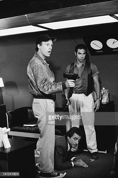 TEAM Firing Line Episode 3 Pictured Dwight Schultz as 'Howling Mad' Murdock Eddie Velez as Frankie Santana Photo by Gary Null/NBCU Photo Bank