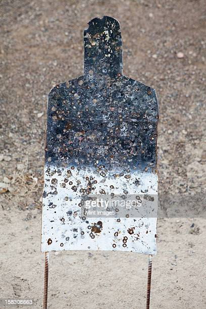 a firing practice target in the shape of a person,  on a desert firing range in nevada. - sportschießen stock-fotos und bilder