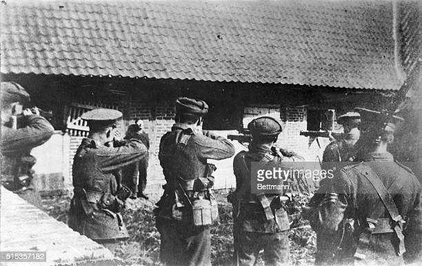 A firing squad composed of British soldiers during World War I aim their rifles at a German spy