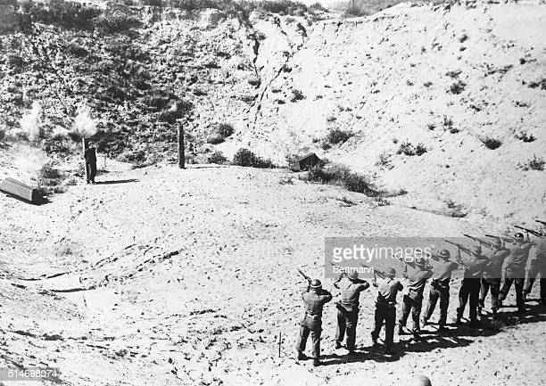 Firing squad of the U.S. Ninth Army puts an end to the young life of Heinz Petry of the Hitler Jugend. Petry was tried as a spy and executed by...