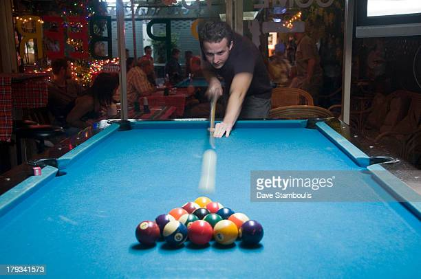 CONTENT] firing the cue ball playing pool in Bangkok Thailand