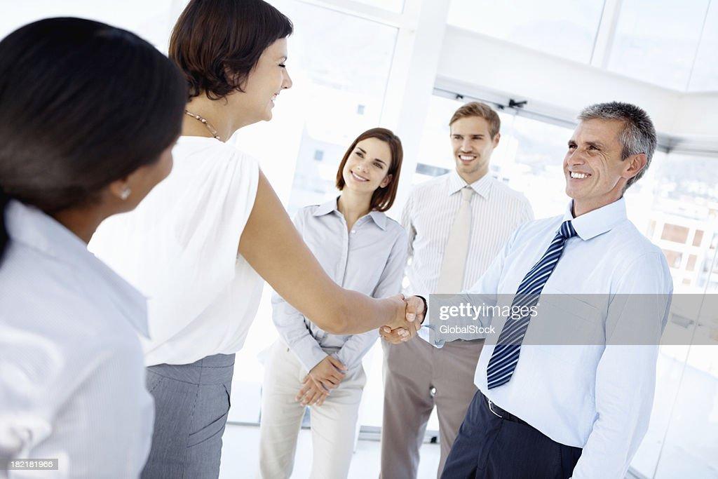 Firm handshake between business associates : Stock Photo