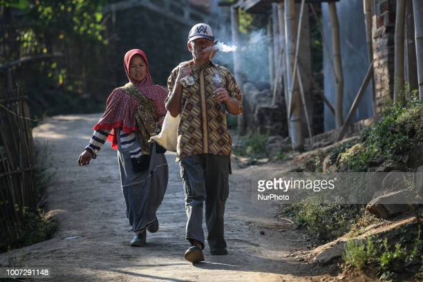 Firman who has albinism with his wife going to rice fields in village of Ciburuy Garut Western Java Indonesia on Thursday July 26 2018 Albinos at...
