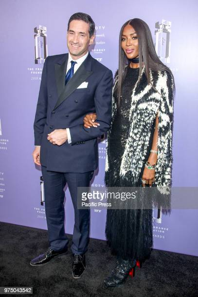 Firmenich Theo Spilka and Naomi Campbell wearing dress by Alexander McQueen attend 2018 Fragrance Foundation Awards at Alice Tully Hall at Lincoln...