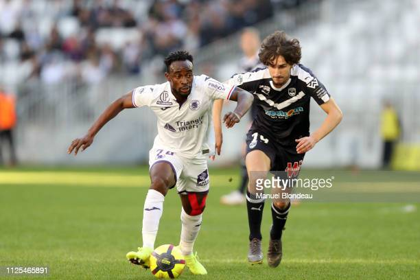 Firmin Mubele of Toulouse and Yacine Adli of Bordeaux during the Ligue 1 match between Bordeaux and Toulouse at Stade Matmut Atlantique on February...