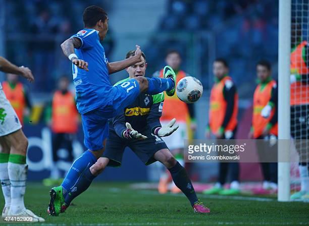 Firmino of 1899 Hoffenheim scores his team's first goal past Borussia Moenchengladbach goalkeeper MarcAndre ter Stegen during the Bundesliga match...