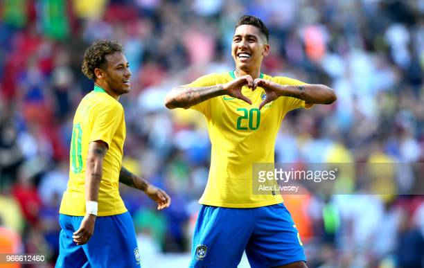 Firmino of Brazil celebrates after scoring his sides second goal as Neymar Jr of Brazil looks on during the International Friendly match between...
