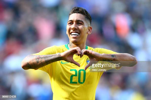 Firmino of Brazil celebrates after scoring his sides second goal during the International Friendly match between Croatia and Brazil at Anfield on...