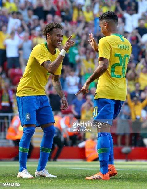 Firmino of Brazil celebrates after scoring his sides second goal with Neymar Jr of Brazil during the International Friendly match between Croatia and...
