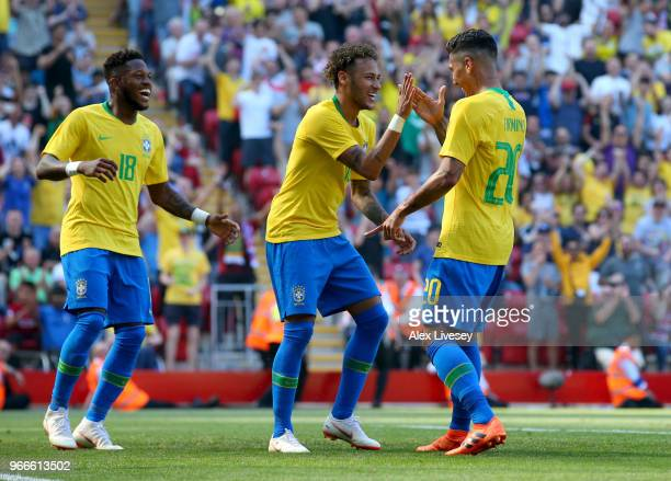 Firmino of Brazil celebrates after scoring his sides second goal with Neymar Jr of Brazil and Fred of Brazil during the International Friendly match...